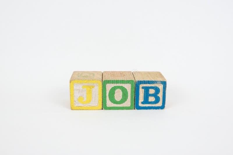 Il lavoro di parola in blocchetti dei bambini di legno immagine stock