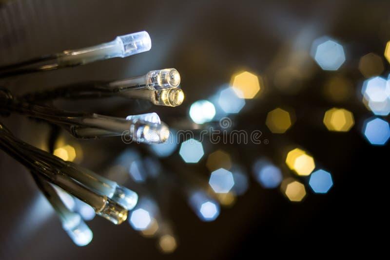 Il LED si accende, lampadine con il fondo del bokeh immagine stock libera da diritti