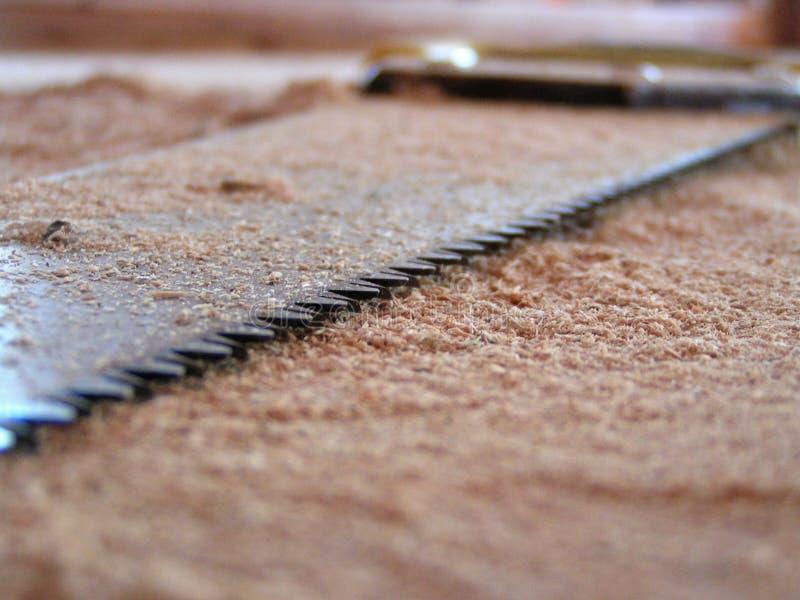 Il legno ha veduto il primo piano fotografie stock libere da diritti