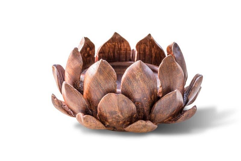 Il legno scolpito loto Isolato su priorità bassa bianca fotografia stock libera da diritti