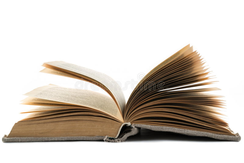 Il libro d'annata aperto in una vecchia copertura del panno si trova su un fondo isolato bianco Struttura orizzontale fotografia stock libera da diritti