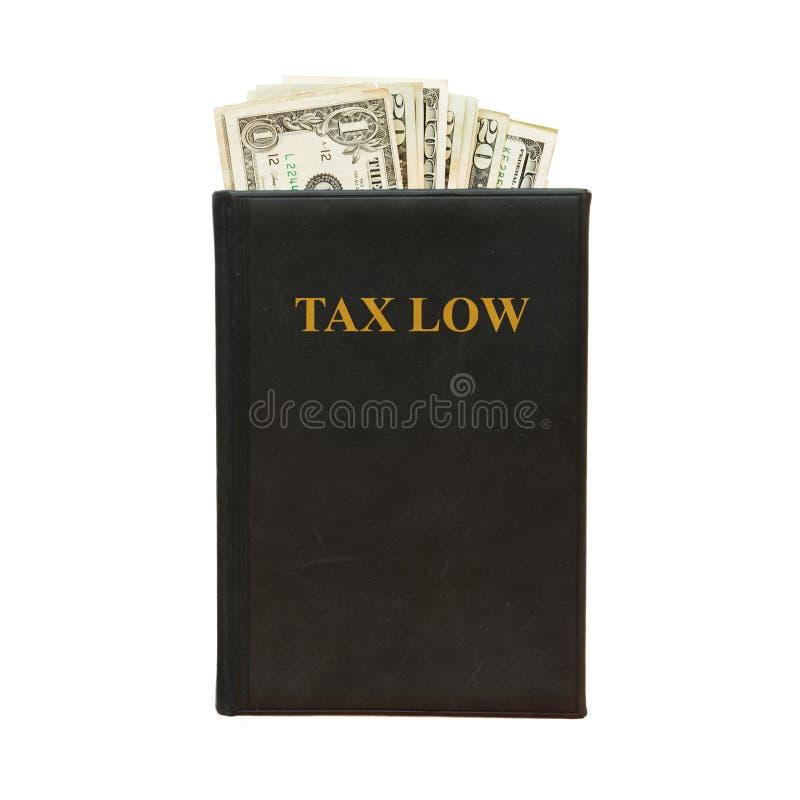 Il libro nero ed i soldi con l'iscrizione tassano il minimo su fondo bianco fotografia stock libera da diritti