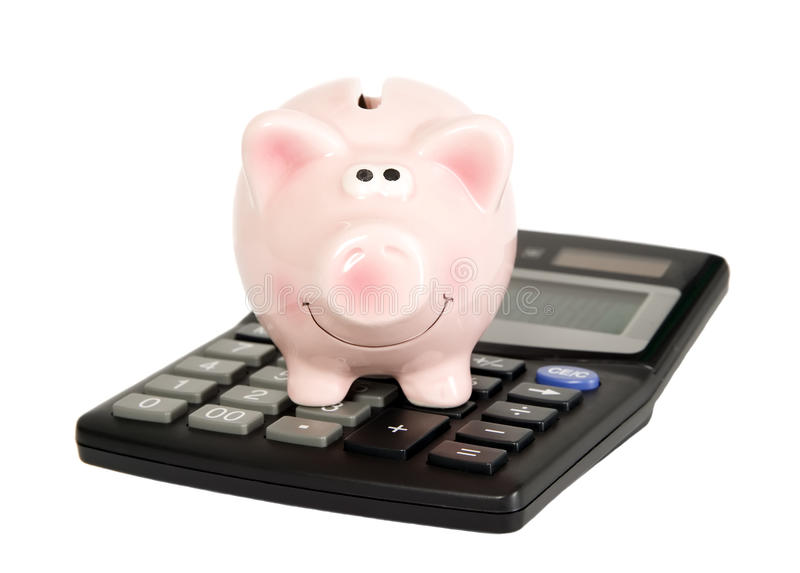 Il maiale di risparmio è sul calcolatore immagini stock libere da diritti