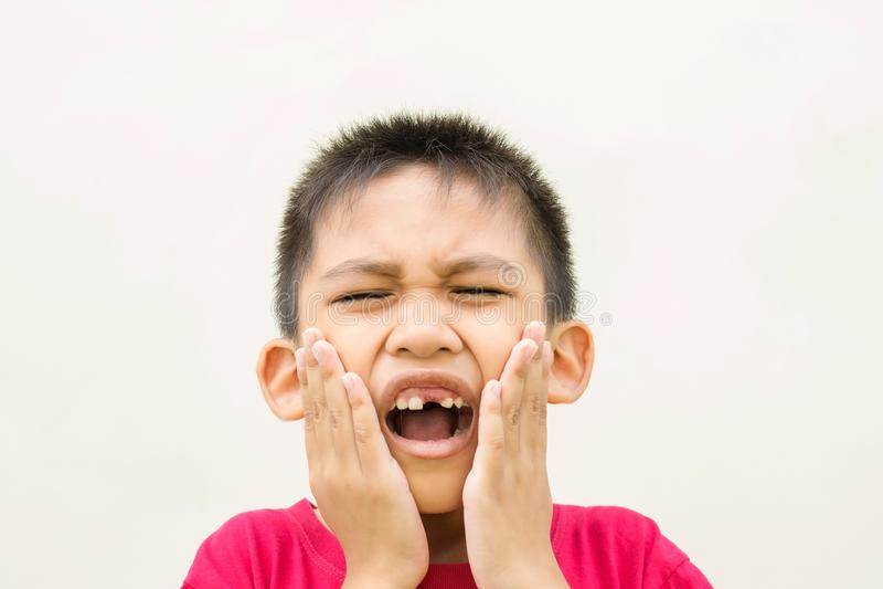 Il mal di denti del ragazzo immagini stock