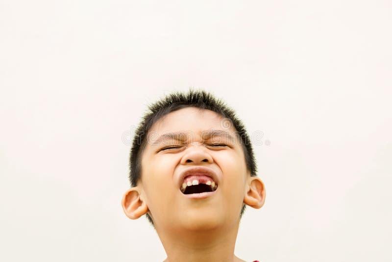 Il mal di denti del ragazzo fotografie stock