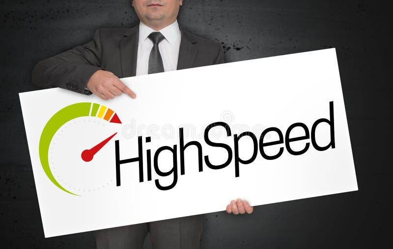 Il manifesto ad alta velocità è tenuto dall'uomo d'affari fotografia stock libera da diritti