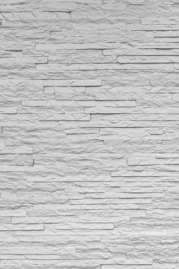 Il mattone di pietra classico bianco è sistemato per modellare sulla parete per bello fondo minimo e semplice immagine stock