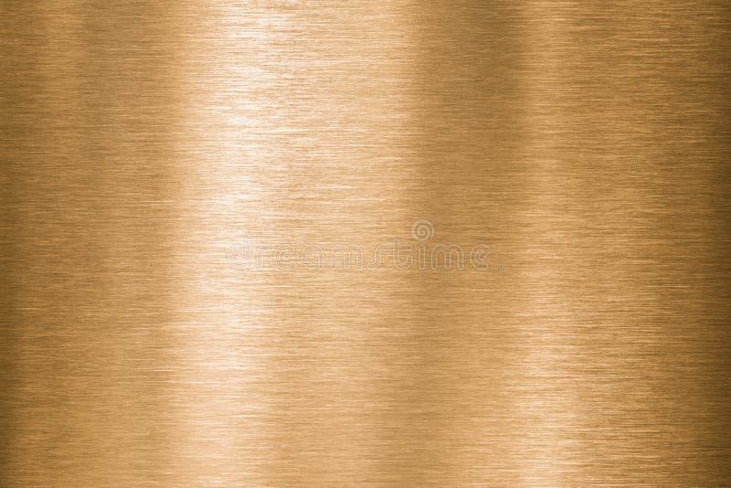 Il metallo dell'oro, del bronzo o del rame ha spazzolato la struttura fotografia stock