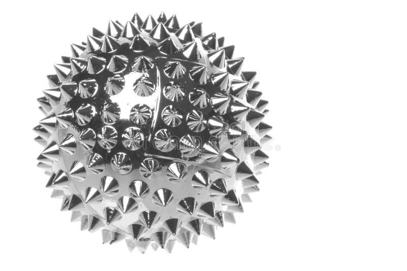 Il metallo ha indicato la macro della sfera isolata fotografia stock