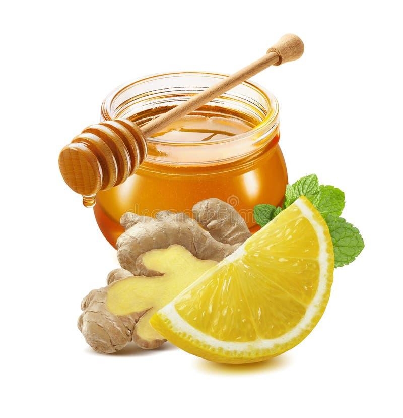 Il miele, limone, zenzero, mint isolato su fondo bianco immagine stock libera da diritti