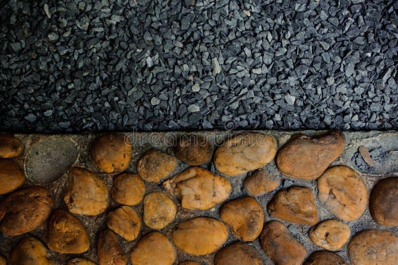 Il modello decorativo del pavimento della sabbia e di piccole pietre della ghiaia, struttura il fondo astratto fotografia stock