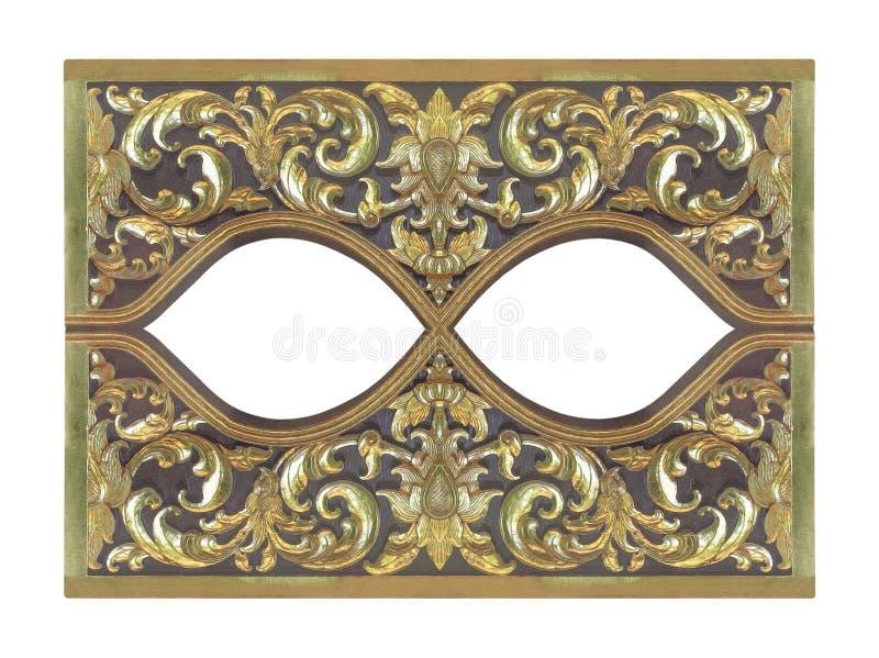 Il modello del fiore di legno dell'oro ha scolpito su fondo di legno immagini stock libere da diritti