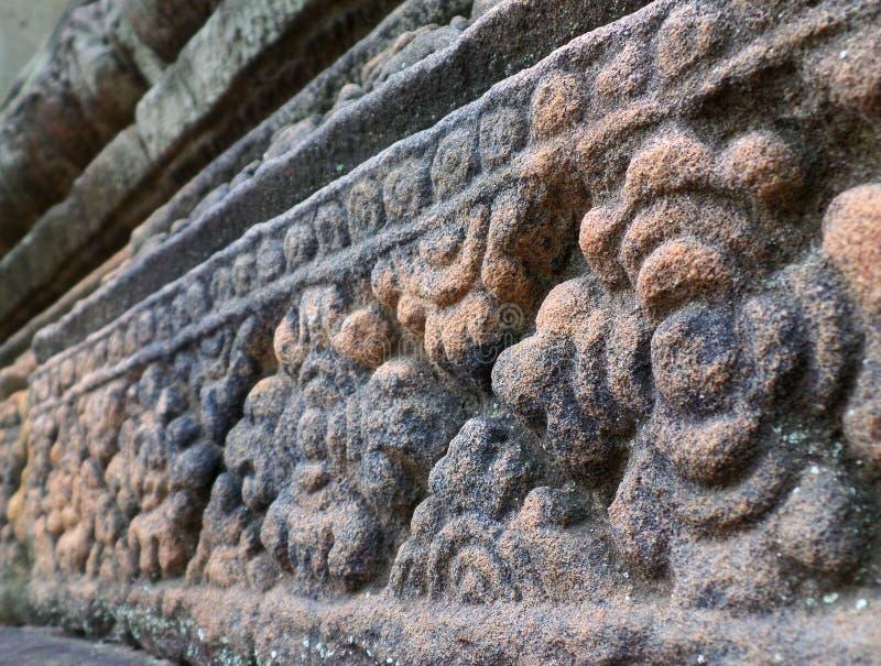 Il modello di fiore ha scolpito la parete di pietra del santuario antico di Prasat Hin Muang Tam, provincia di Buriram fotografia stock