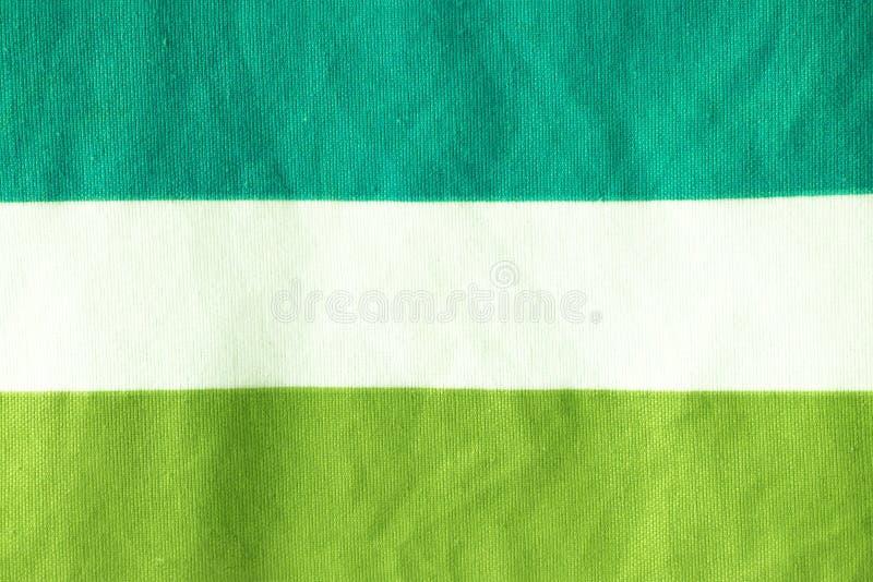 Il modello la superficie del tessuto è contrapposizione verde e bianca fotografia stock