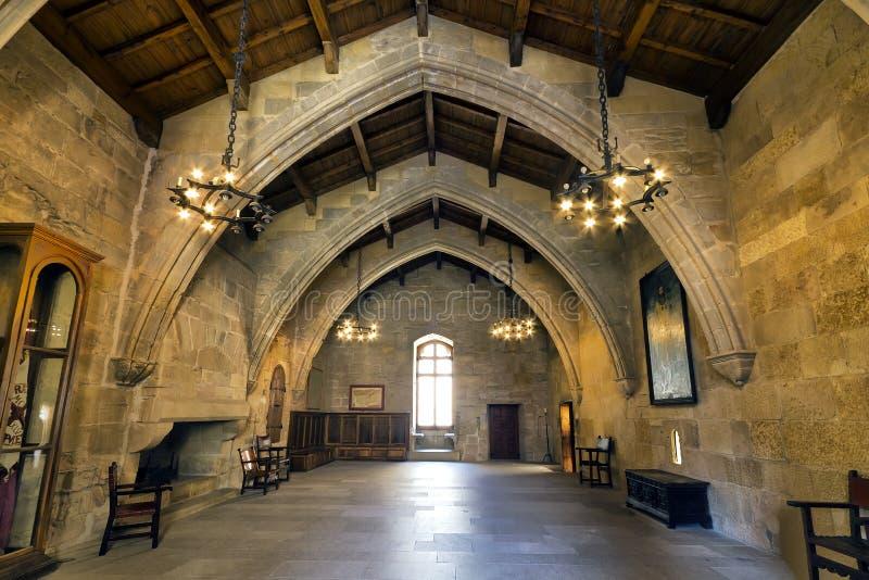 Il monastero di Santa Maria de Poblet inbandiera la stanza fotografia stock libera da diritti