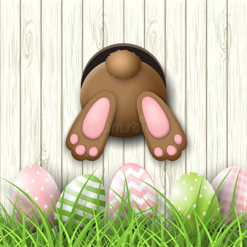 Il motivo di Pasqua, andeaster inferiore del coniglietto eggs in erba fresca su fondo di legno bianco, illustrazione illustrazione di stock