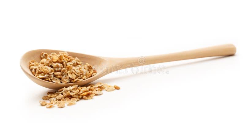 Il mucchio dell'avena si sfalda con il cucchiaio di legno fotografia stock libera da diritti