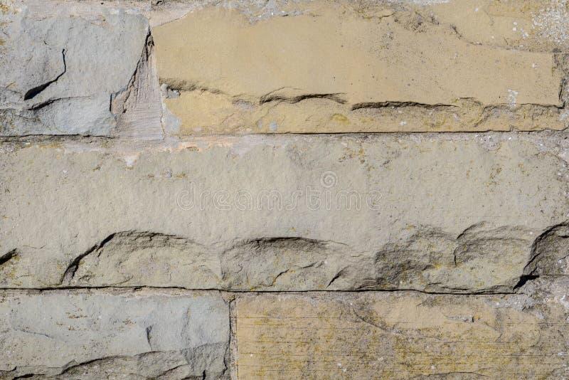 Il muro di mattoni decorativo della casa dell'estratto piastrella il fondo di progettazione del modello immagini stock libere da diritti
