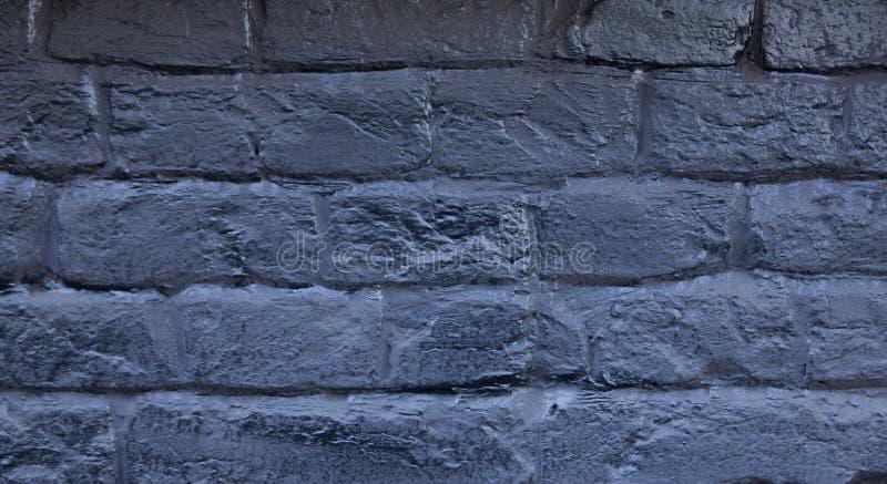 Il muro di mattoni dipinto in blu Fondo di vecchio muro di mattoni blu d'annata Muro di mattoni blu Muro di mattoni blu scuro del fotografia stock libera da diritti