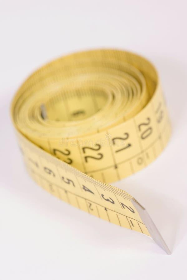 Il nastro di misurazione del sarto fotografia stock