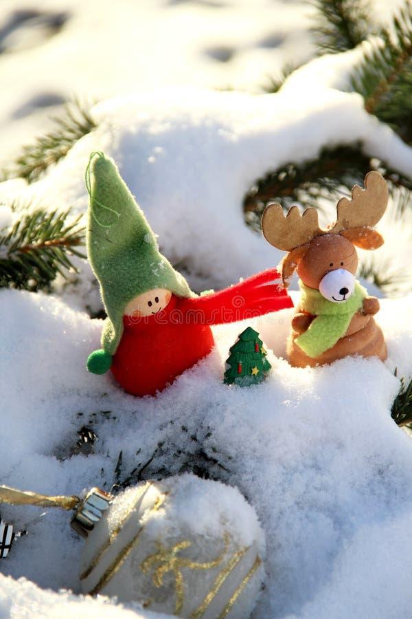 Il Natale cronometra con i giocattoli fotografia stock