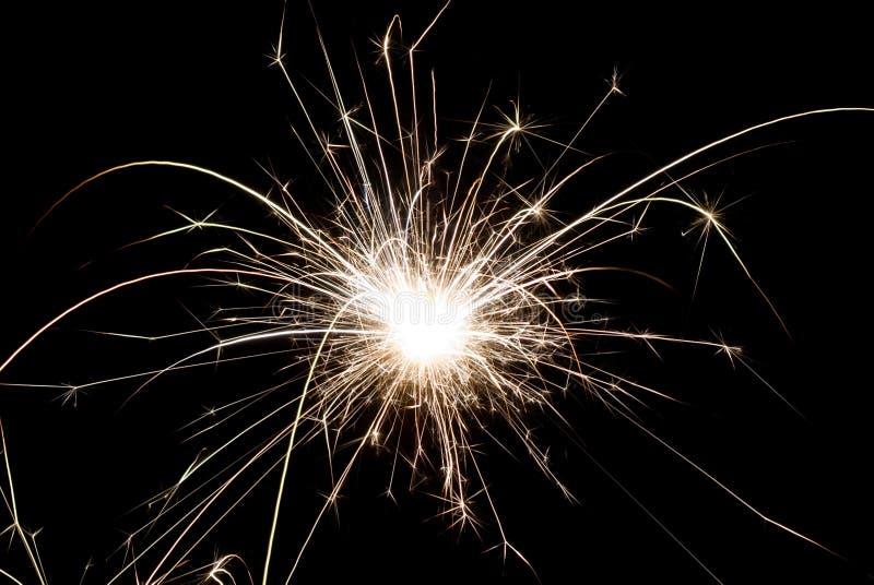 Il Natale ed il nuovo anno scintilla le ustioni su fondo nero fotografie stock libere da diritti