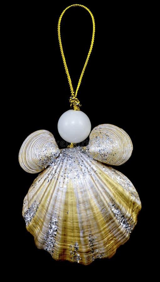 Il Natale gioca la catena chiave dalle conchiglie e dalle perle con la corda dell'oro isolata immagine stock
