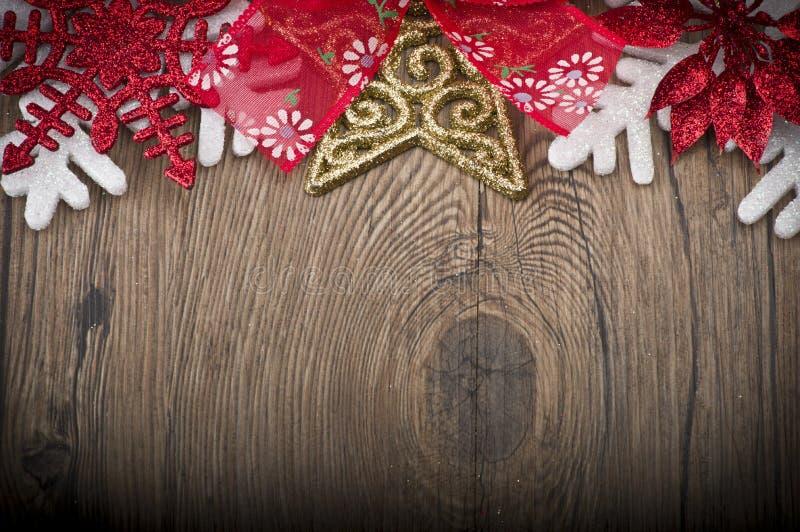Il Natale incornicia sulla tavola di legno fotografia stock libera da diritti