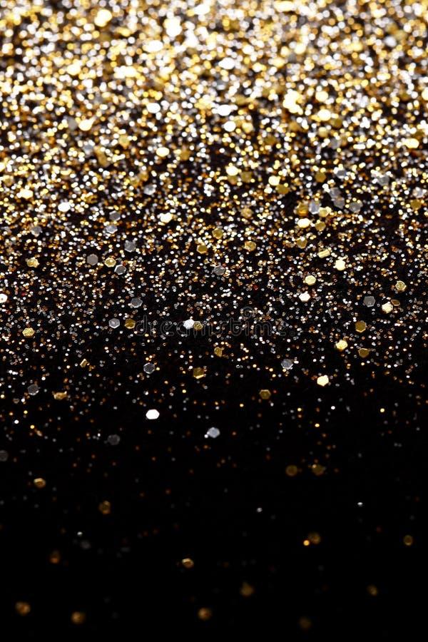 Il nero del nuovo anno di Natale e fondo di scintillio dell'oro Tessuto astratto di struttura di festa fotografie stock libere da diritti
