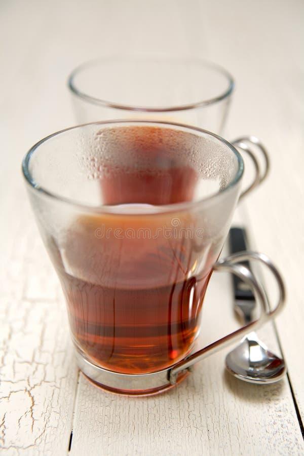 Il nero del tè fotografia stock