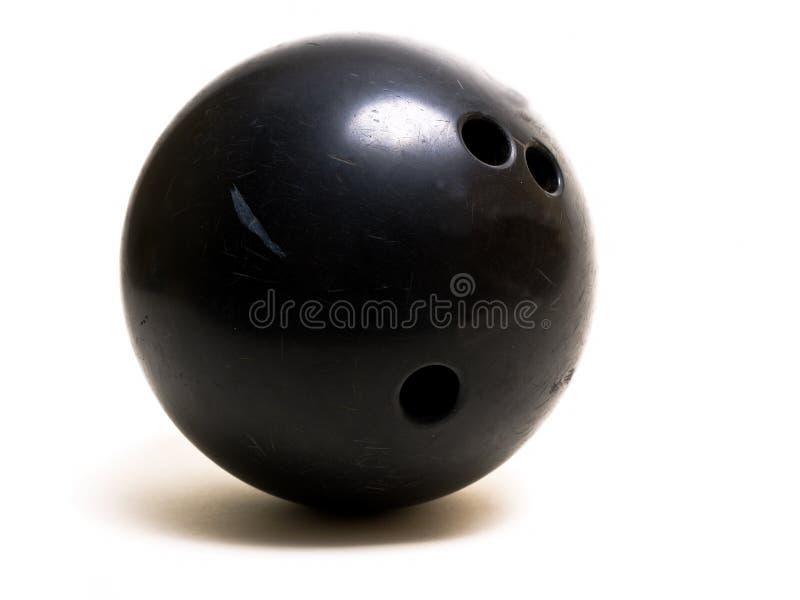 Il nero della sfera di bowling immagini stock