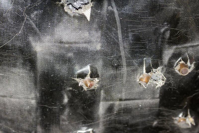 Il nero della superficie con le pallottole ha messo il giubbotto antiproiettile del pericolo della protezione di controllo di sic immagine stock libera da diritti