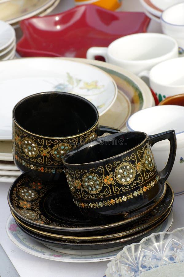 Il nero delle tazze da caffè fotografie stock