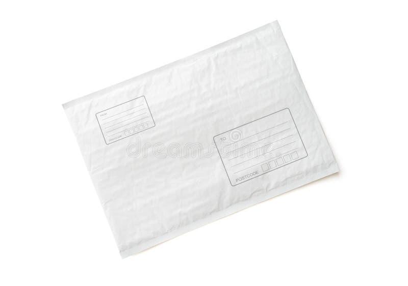 Il pacco postale bianco con area per scrive l'indirizzo Fondo di plastica dell'oggetto del pacchetto per la pubblicità di compera fotografie stock