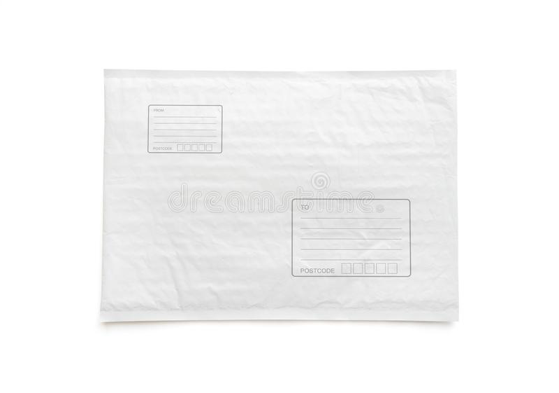 Il pacco postale bianco con area per scrive l'indirizzo Fondo di plastica dell'oggetto del pacchetto per la pubblicità di compera fotografia stock libera da diritti