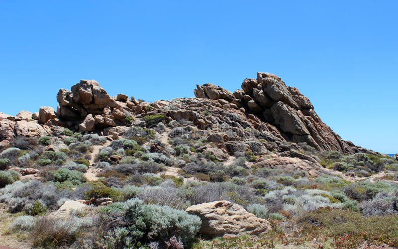 Il paesaggio roccioso drammatico al canale oscilla l'Australia occidentale di estate immagini stock