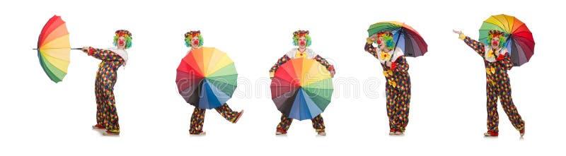 Il pagliaccio con l'ombrello isolato su bianco fotografie stock