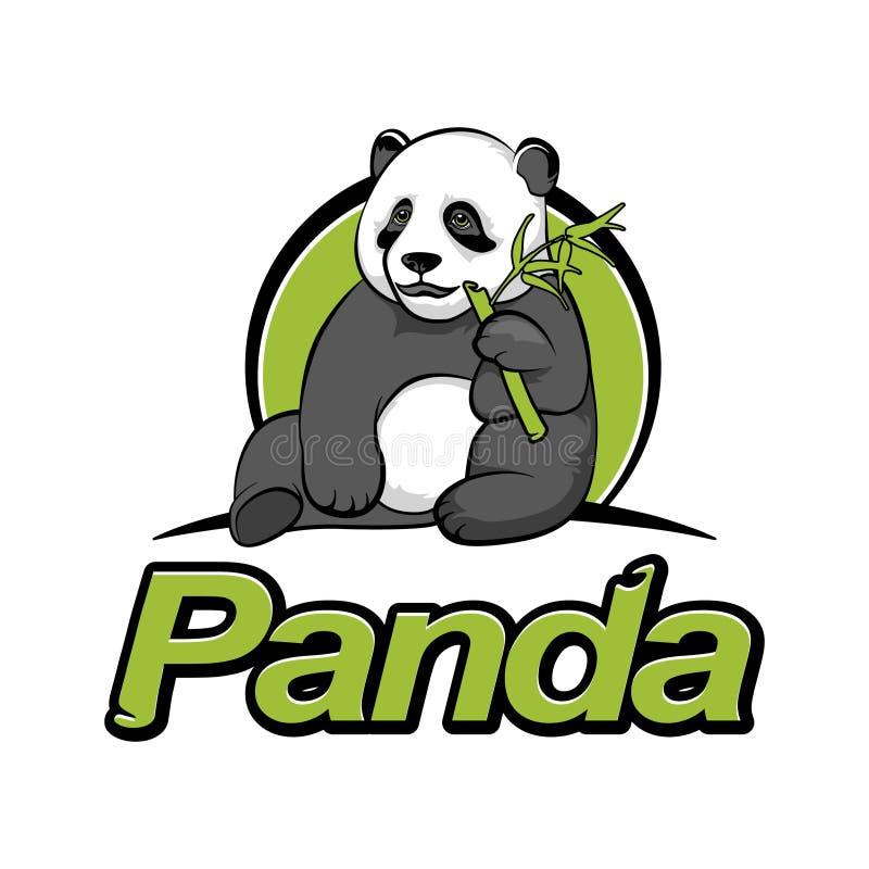 Il panda si siede e mangia il bambù fotografia stock