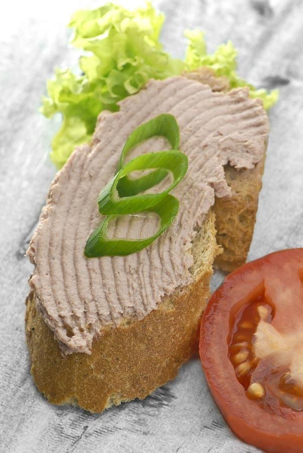 Il pane con la diffusione e guarnisce immagini stock libere da diritti