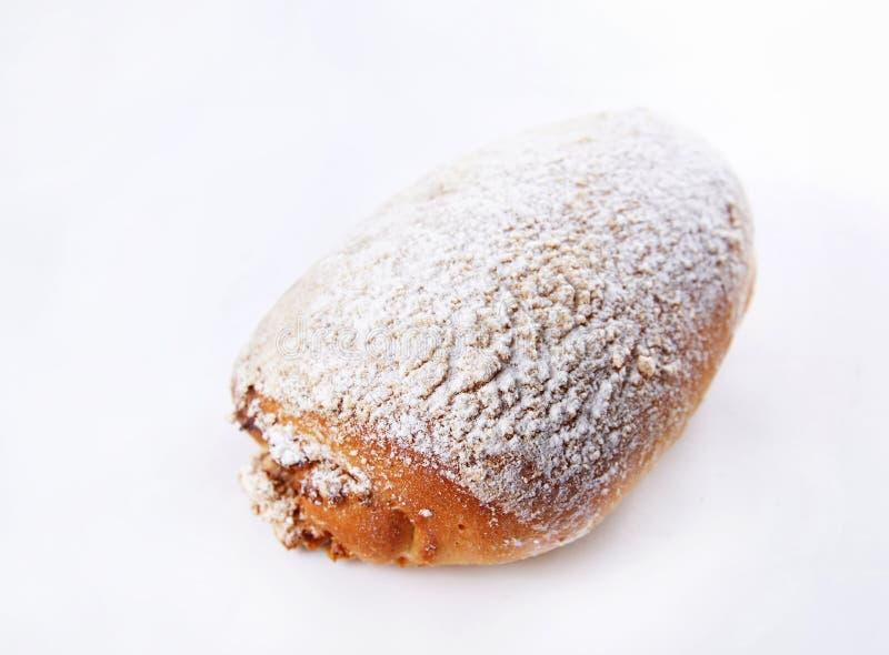 Il panino cotto ha impolverato con lo zucchero in polvere immagini stock