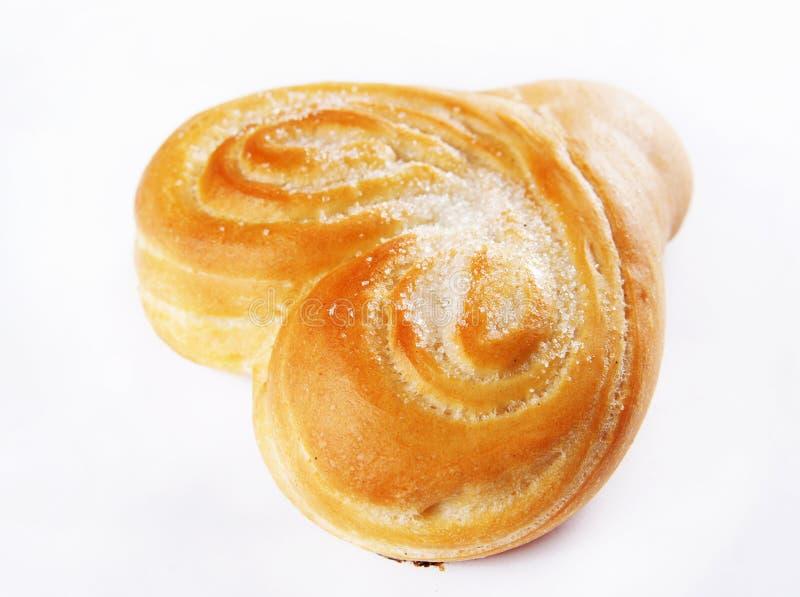 Il panino di recente cotto ha impolverato con lo zucchero fotografia stock libera da diritti