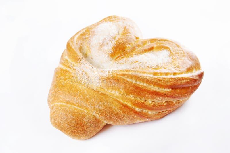 Il panino di recente cotto ha impolverato con lo zucchero immagine stock libera da diritti