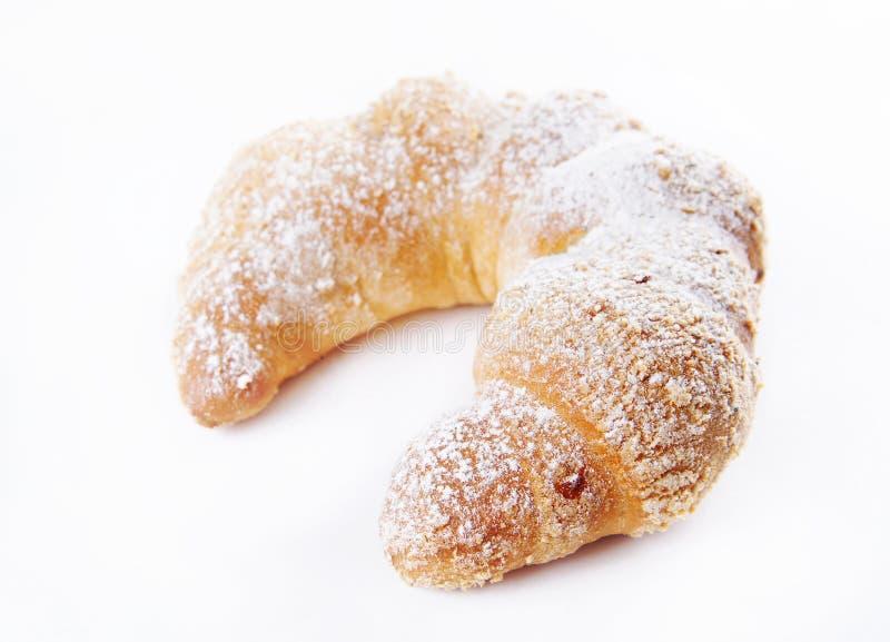 Il panino ha impolverato con la polvere dello zucchero immagini stock libere da diritti