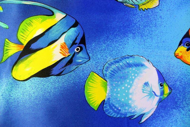 Il pesce nautico di tema del tessuto del fondo fotografia stock libera da diritti