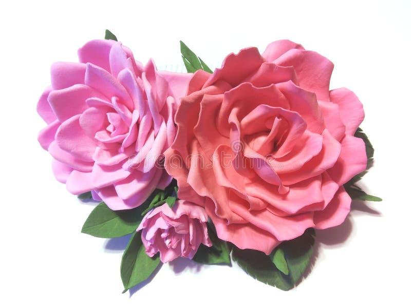 Il pettine dei capelli con le rose rosa fotografia stock