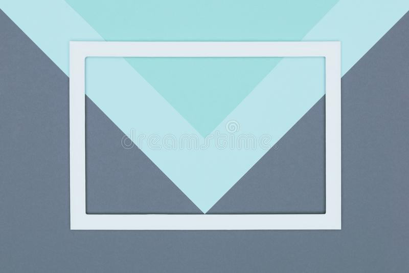 Il piano pastello geometrico astratto del blu, del turchese e della carta colorata di grey pone il fondo Minimalismo, la geometri fotografia stock