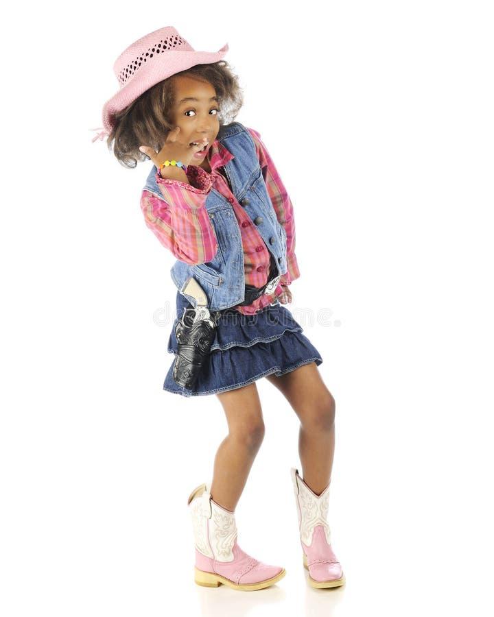 Il piccolo cowgirl sopra finge il telefono fotografia stock