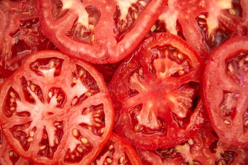Il pomodoro affetta la priorità bassa immagine stock libera da diritti