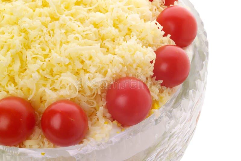 Il pomodoro di ciliegia e del formaggio ha superato l'insalata in ciotola a cristallo fotografia stock libera da diritti