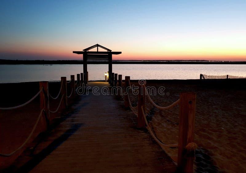 Il pontone della spiaggia di Marennes una sera fotografia stock libera da diritti